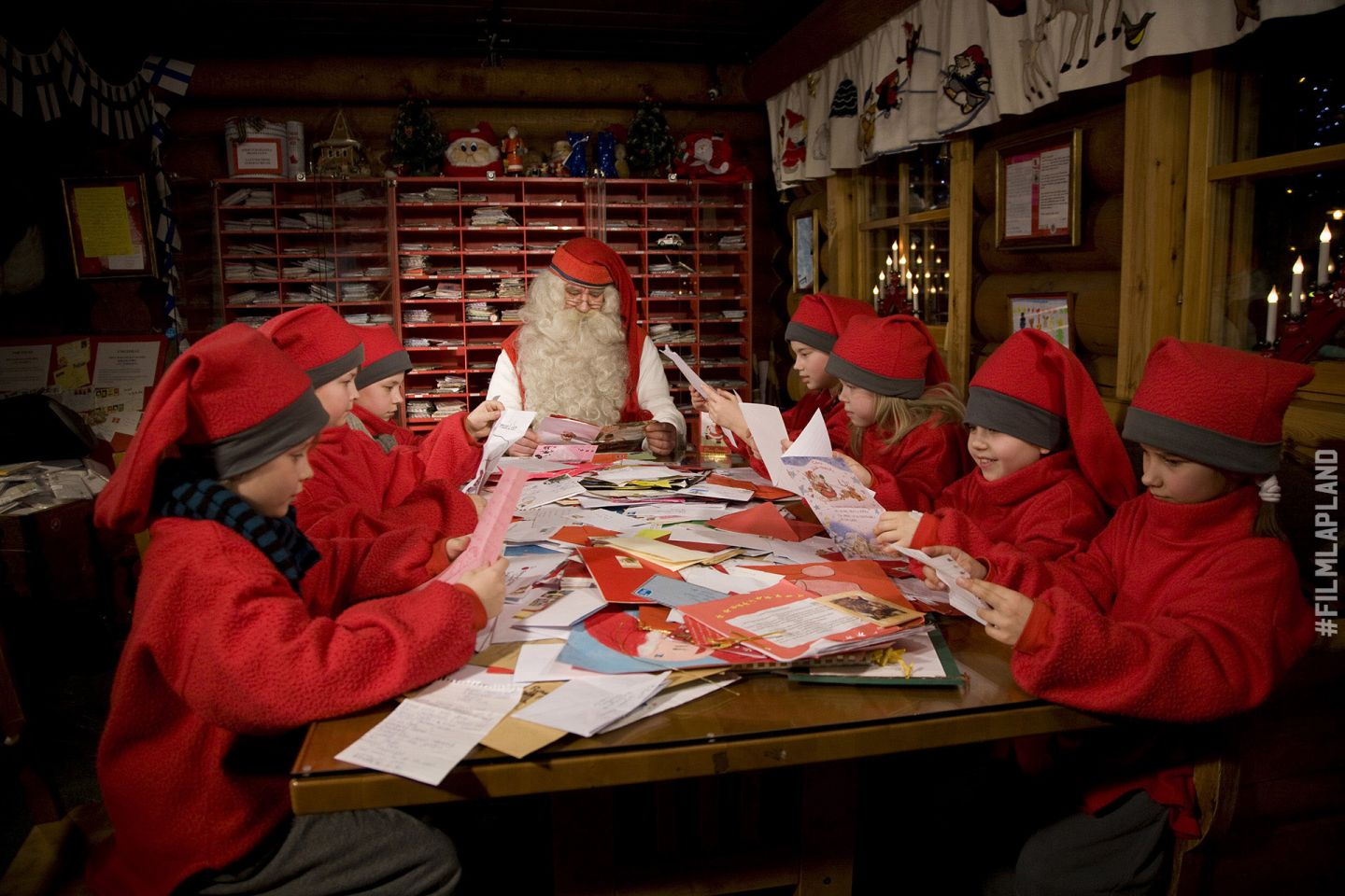 Santa Claus and elves working at the Santa Claus Main Post Office in Rovaniemi, Finland