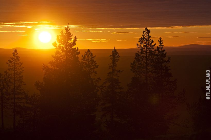 Midnight Sun over the horizon in Rovaniemi, Finland