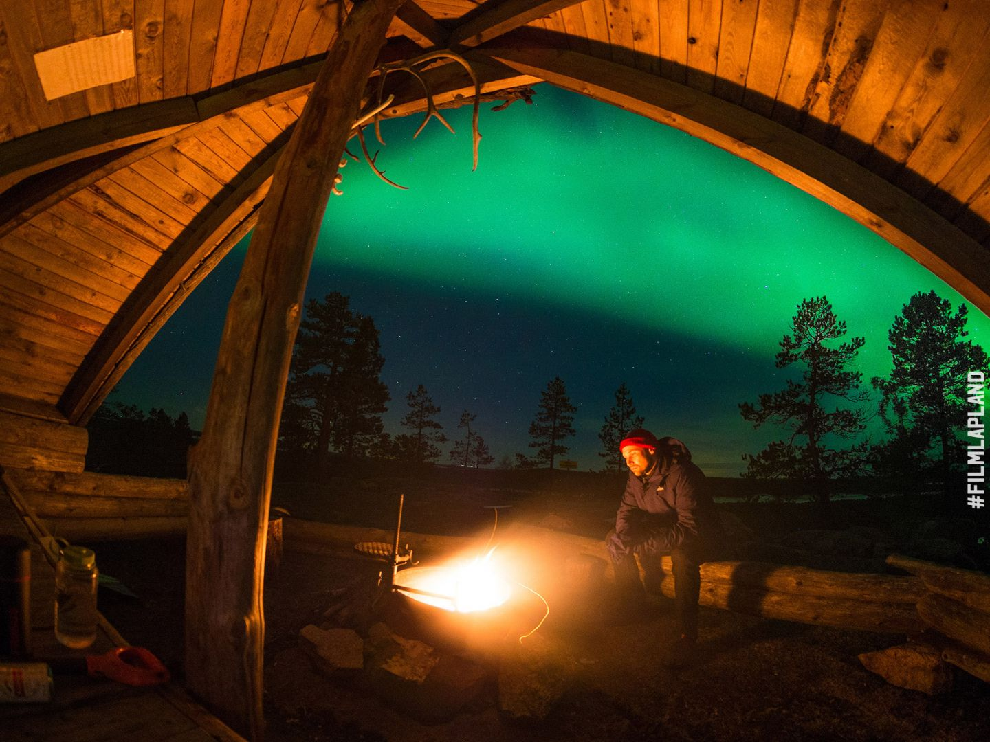Northern Lights over a hut in Rovaniemi, Finland