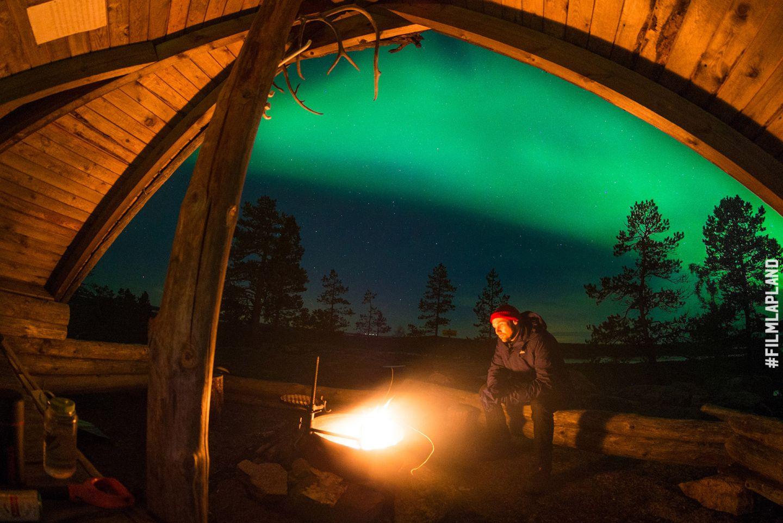 Northern Lights over a hut in Rovaniemi, Finland