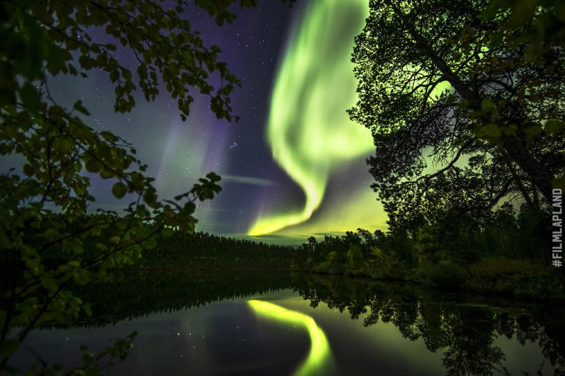 Northern Lights reflected in Lapland lake