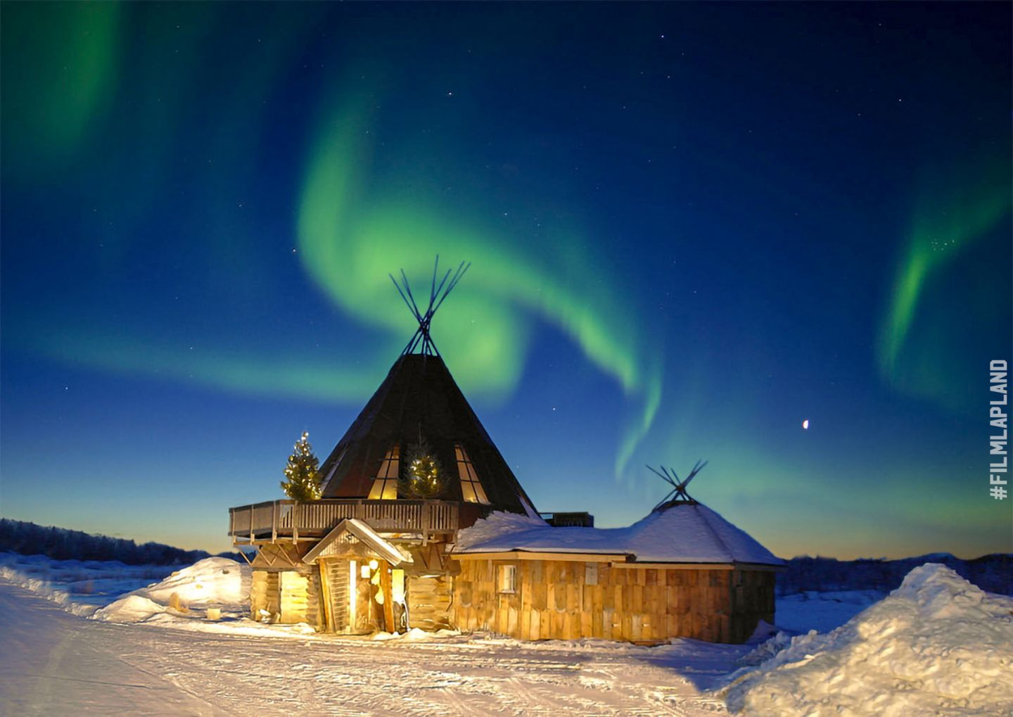 Northern Lights over a frosty hut in Levi, Finland