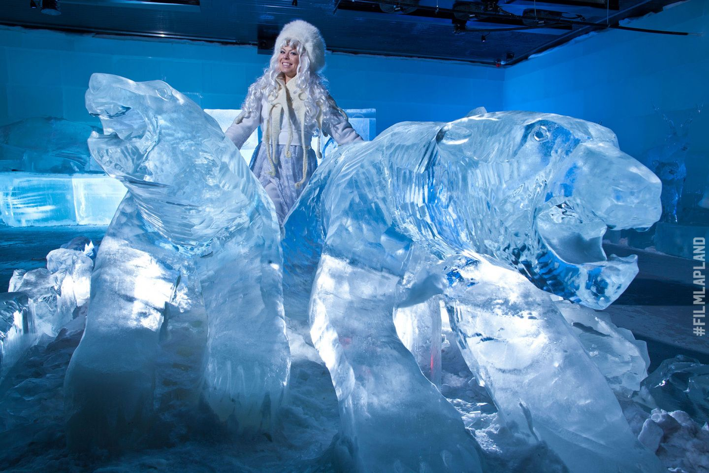 Ice princess among the ice sculptures in SantaPark in Rovaniemi, Finland