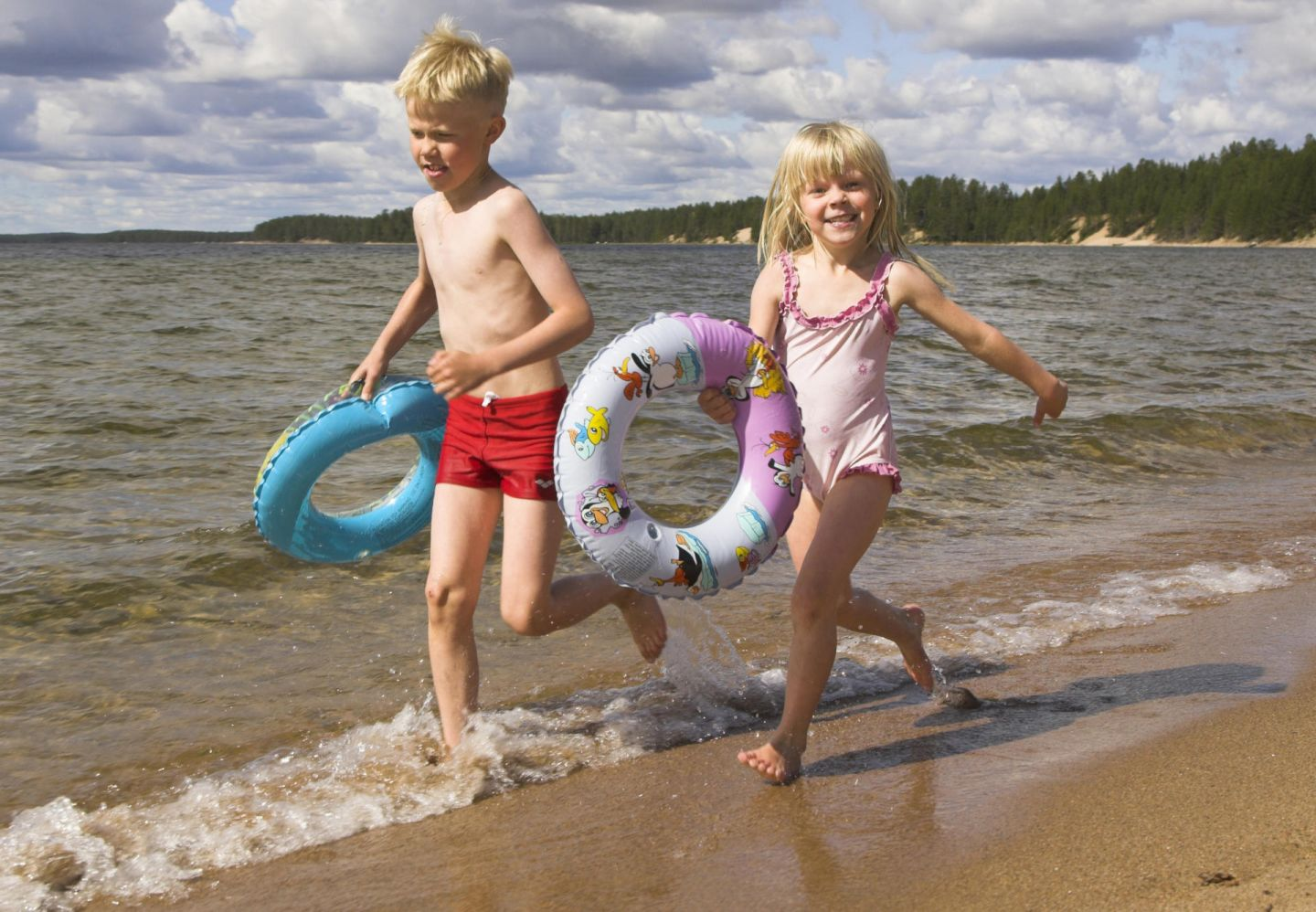 Children play on the beach in Posio, Finland