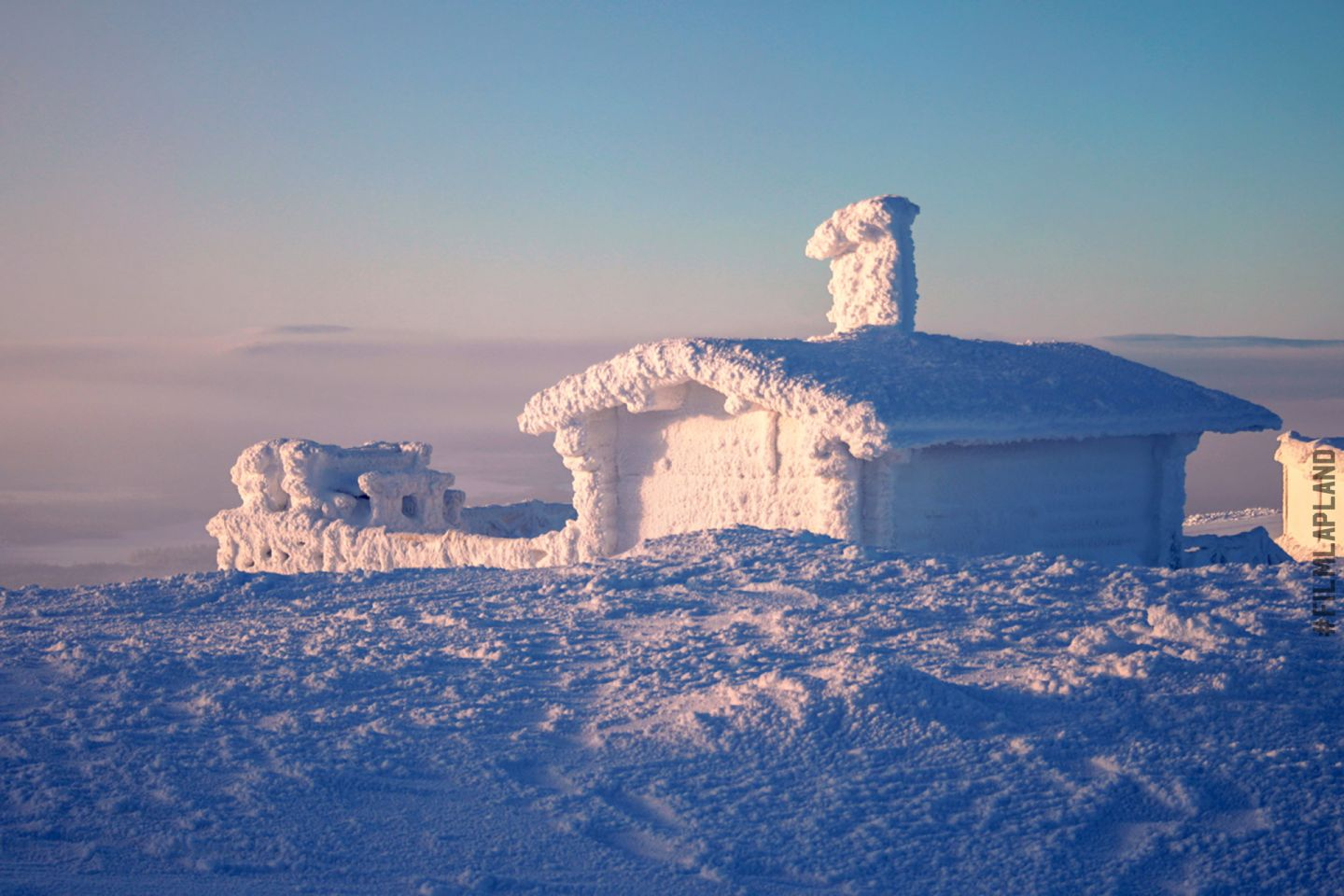 snow-covered cottage in Levi, Finland