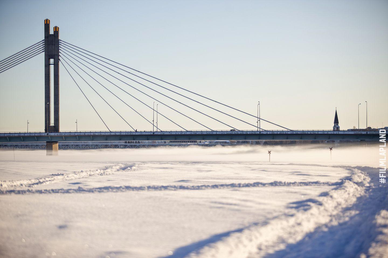 Lumberjack Candle bridge over frozen river in Rovaniemi, Finland