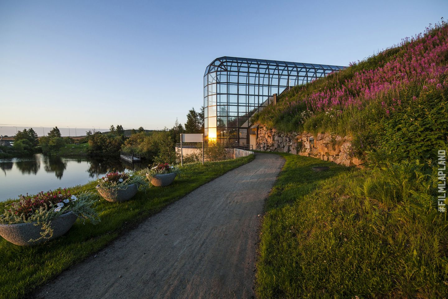 Glass walls of Arktikum museum in Rovaniemi, Finland in summer