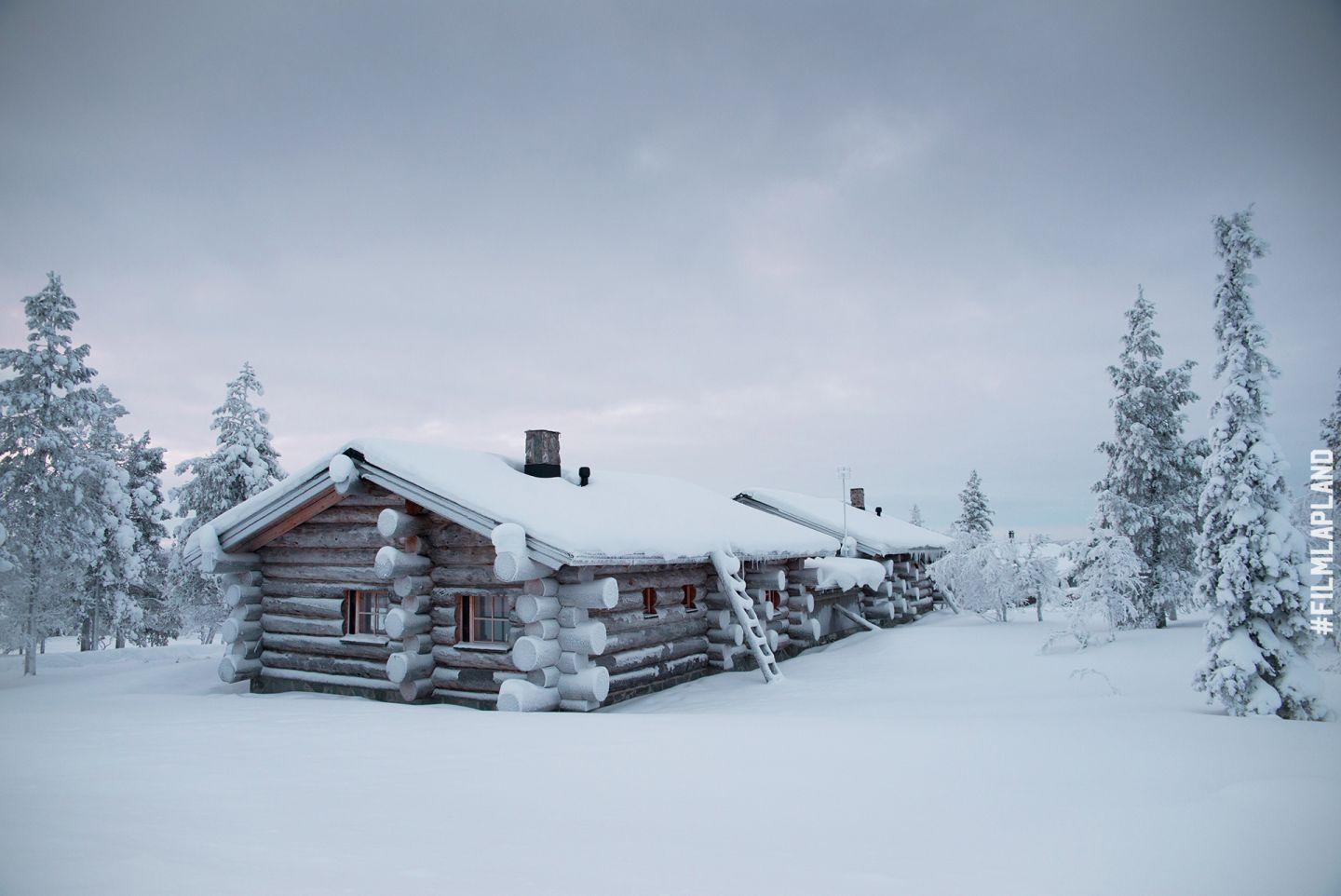 Snowy log cabin in Inari, Finland