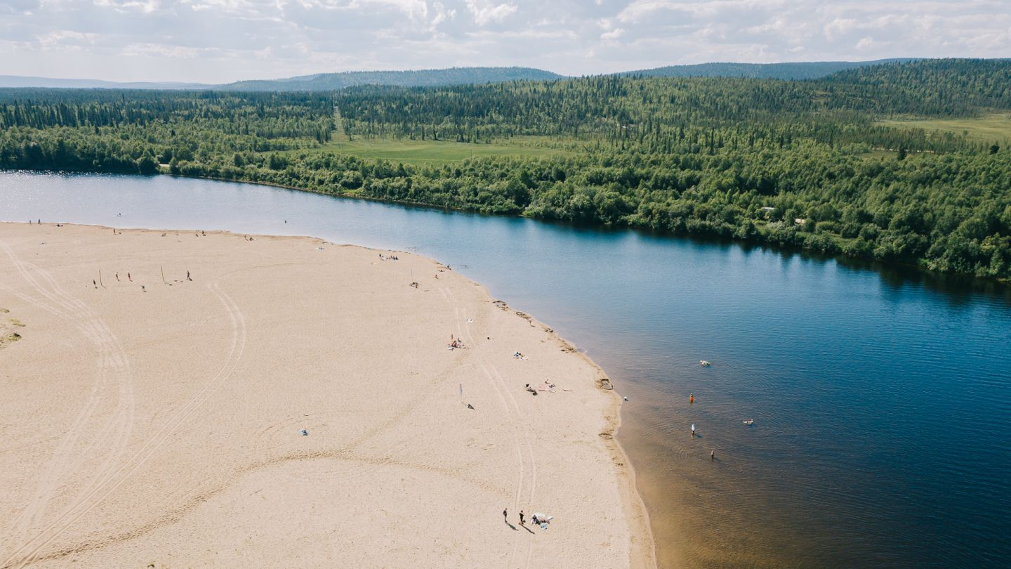 Large sand beach by the forest in Ivalo, Finland