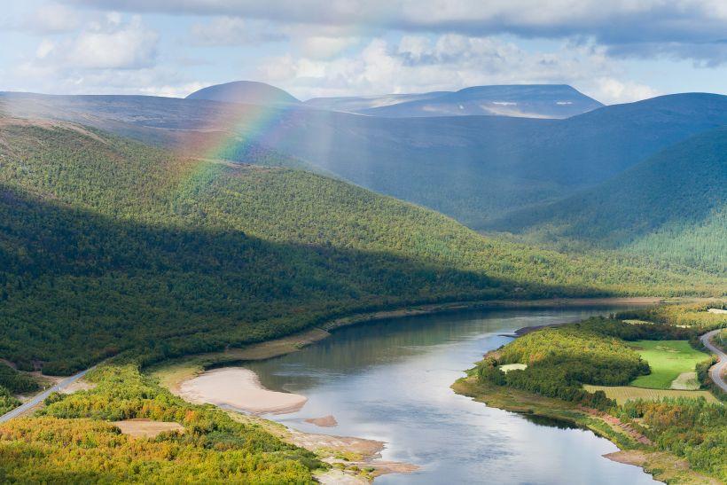 Beautiful landscape with rainbow and scandinavian mountains in Utsjoki, Finland