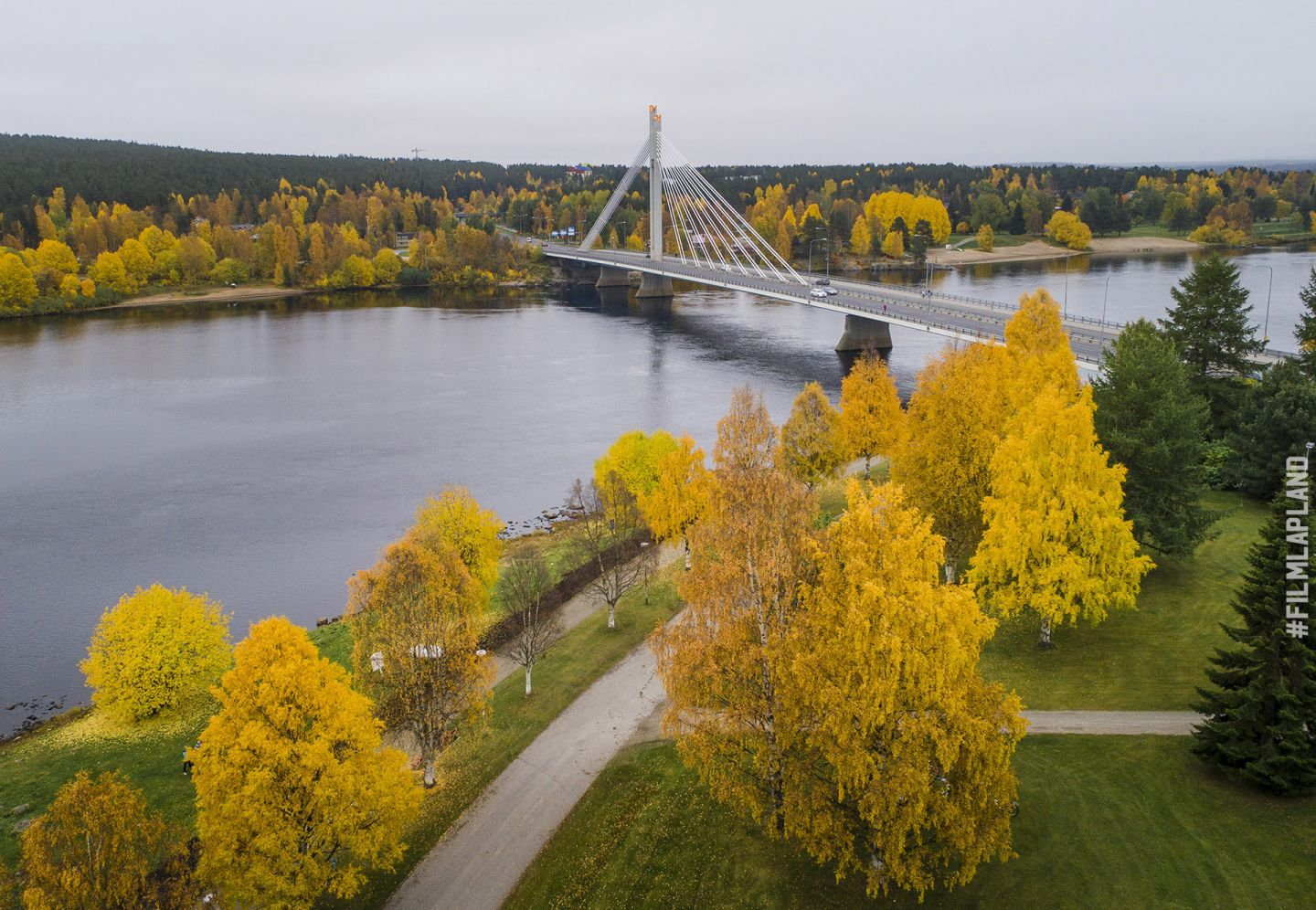 Lumberjack Candle Bridge in Rovaniemi, Finland in autumn