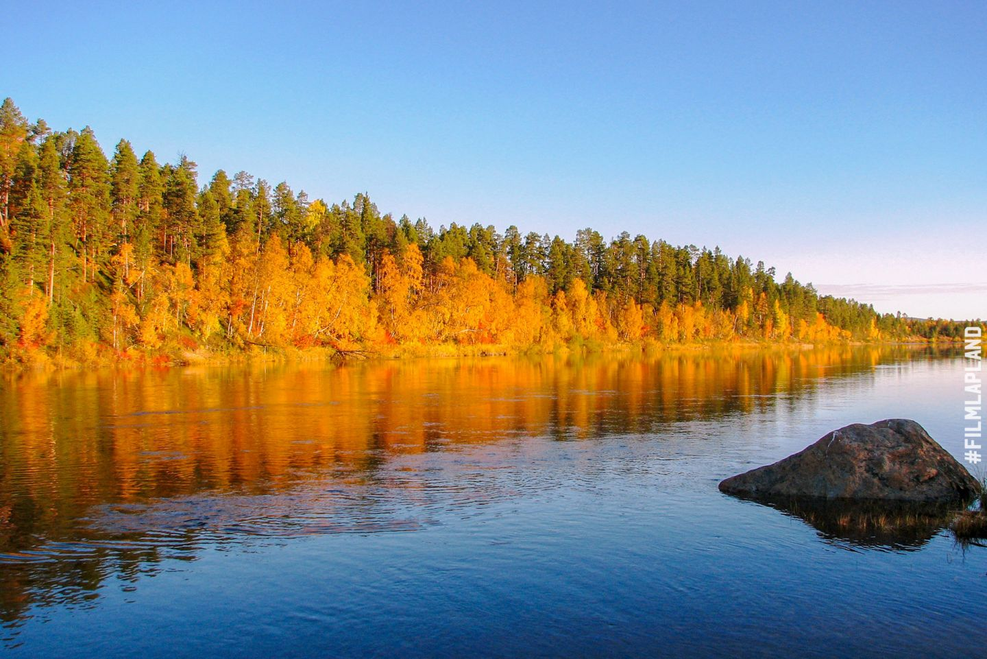 River and forest in Inari, Finland in autumn
