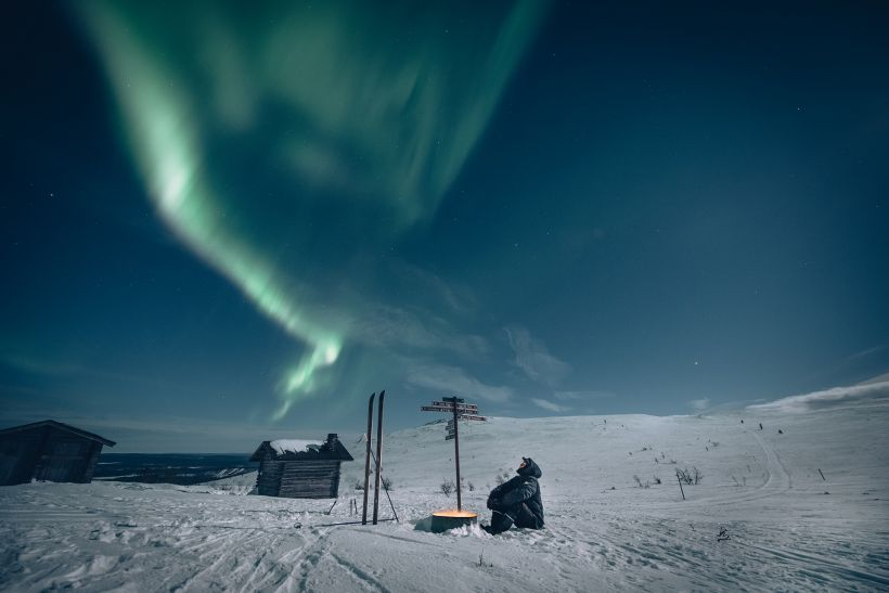 Enjoying the silence of the wilderness under Northern Lights in Muonio Lapland