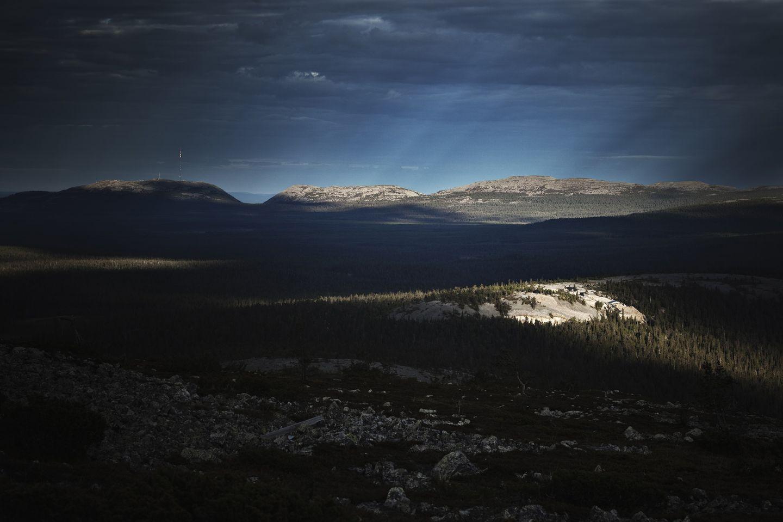 Sun rays touching the fell in the darkness in Luosto Sodankylä, Lapland