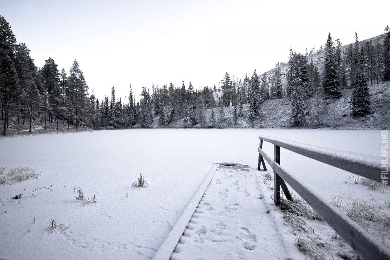 Dock atop a frozen lake in Pelkosenniemi, Finland