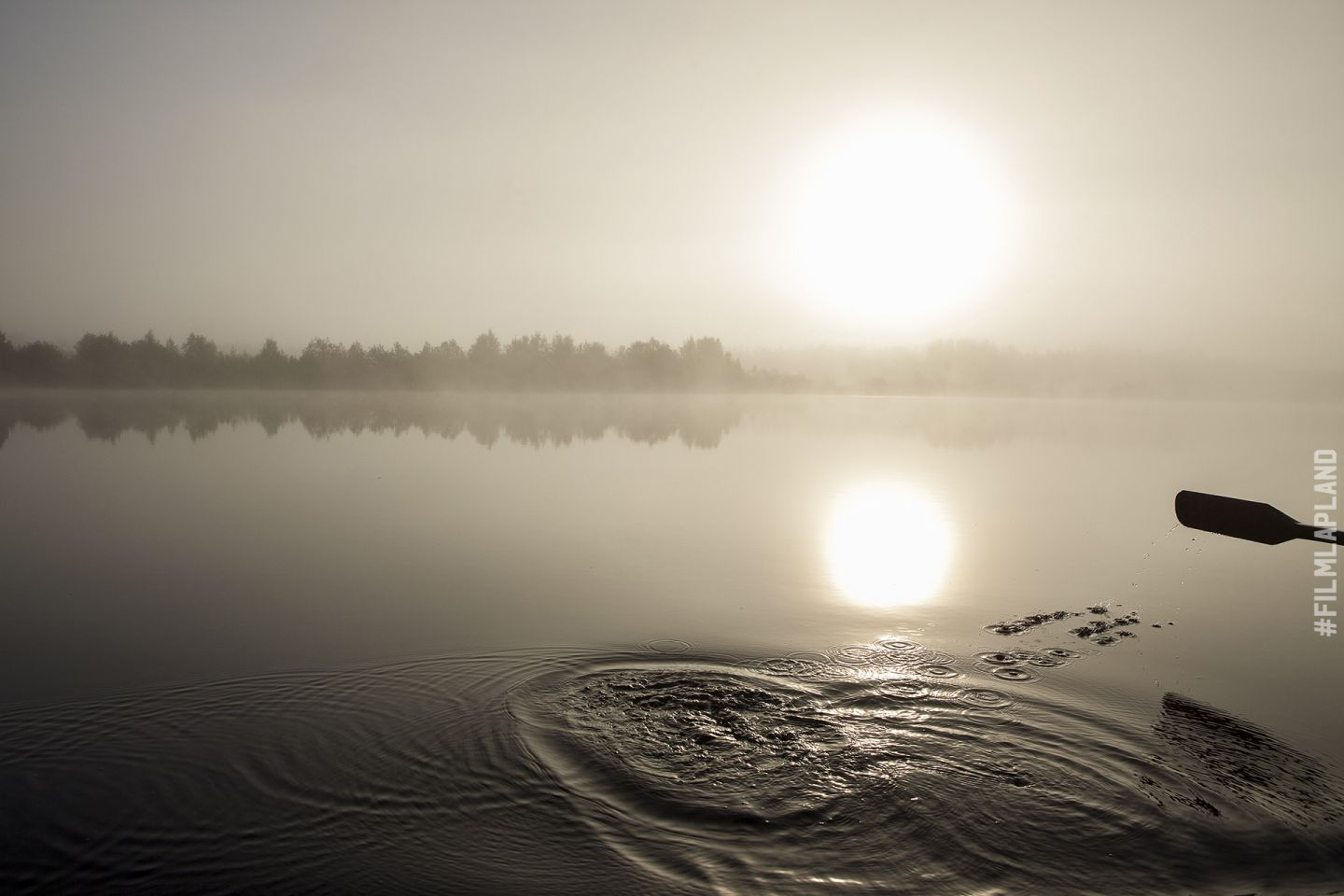 Midnight Sun over a misty lake in Sodankylä, Finland
