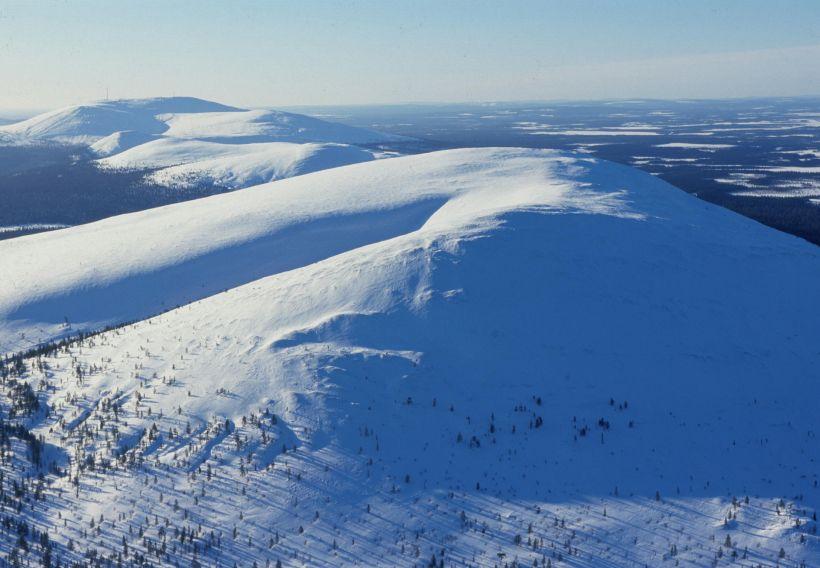 Treeless hill in winter wilderness in Kolari, Lapland