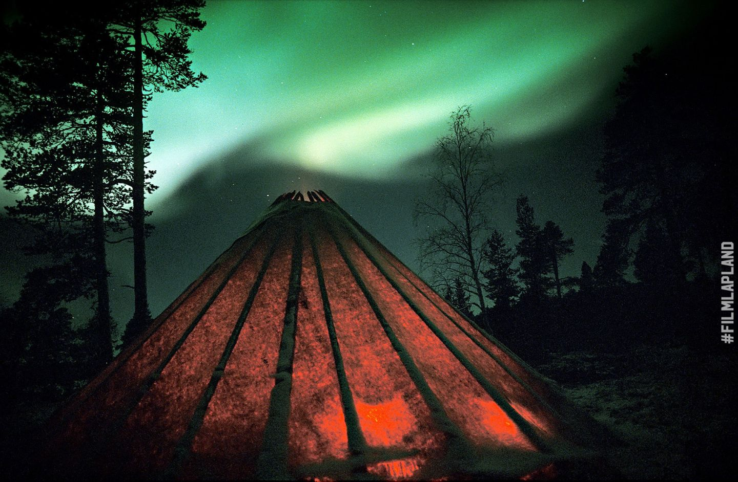 Northern Lights over a hut in Inari, Finland