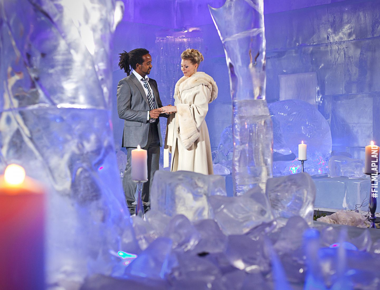 Wedding among the ice sculptures in SantaPark, Rovaniemi, Finland