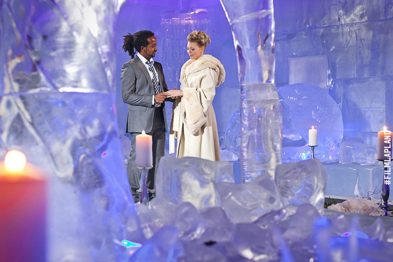 Wedding among the ice sculptures in SantaPark, Rovaniemi, Finland
