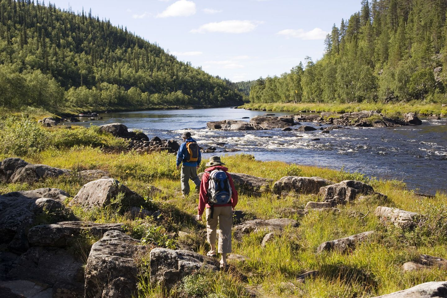 hiking beside a river in inari, northern finland, a possible filming location
