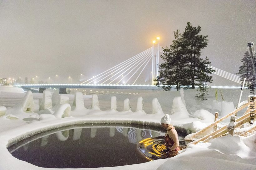 Ice swimming by the Lumberjack Candle Bridge in Rovaniemi, Lapland