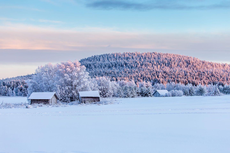 Sun rays touching a frozen hill in Kemijärvi, Lapland