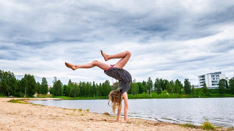 handstand on a kemijärvi beach | beaches in finland