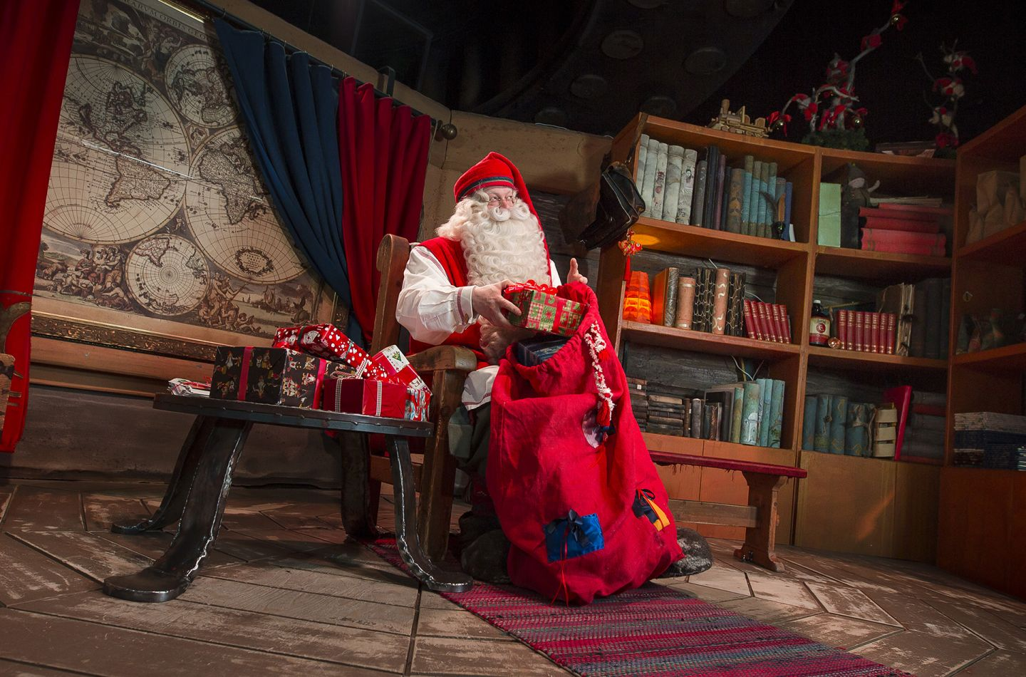 Santa Claus with his gift sack in his office in Rovaniemi, Finland