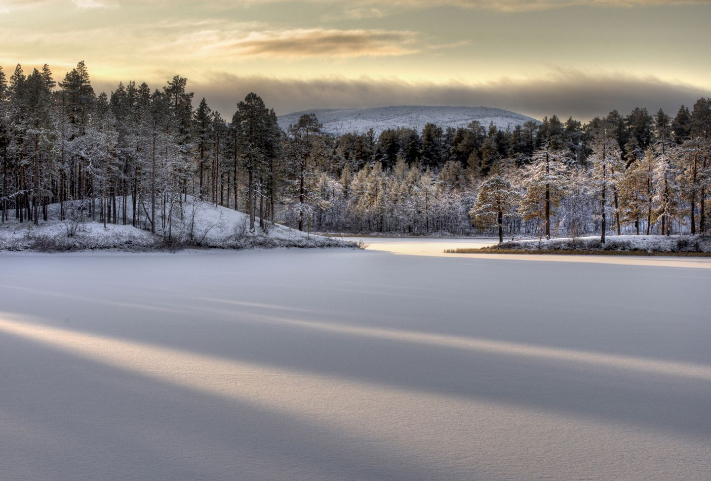 Frozen lake Inarijärvi ready for ice-skating, Inari, Finland
