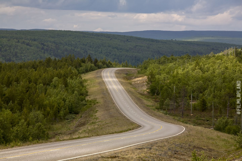 Small road through Arctic hills, in Inari, Finland