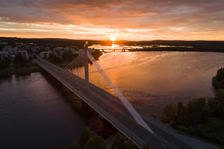 August sun behind lumbejack's candle bridge in Rovaniemi, Finland