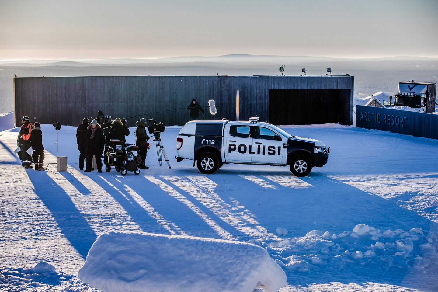 film crew following a police vehicle on the set of Arctic Circle, filmed in Lapland, Finland