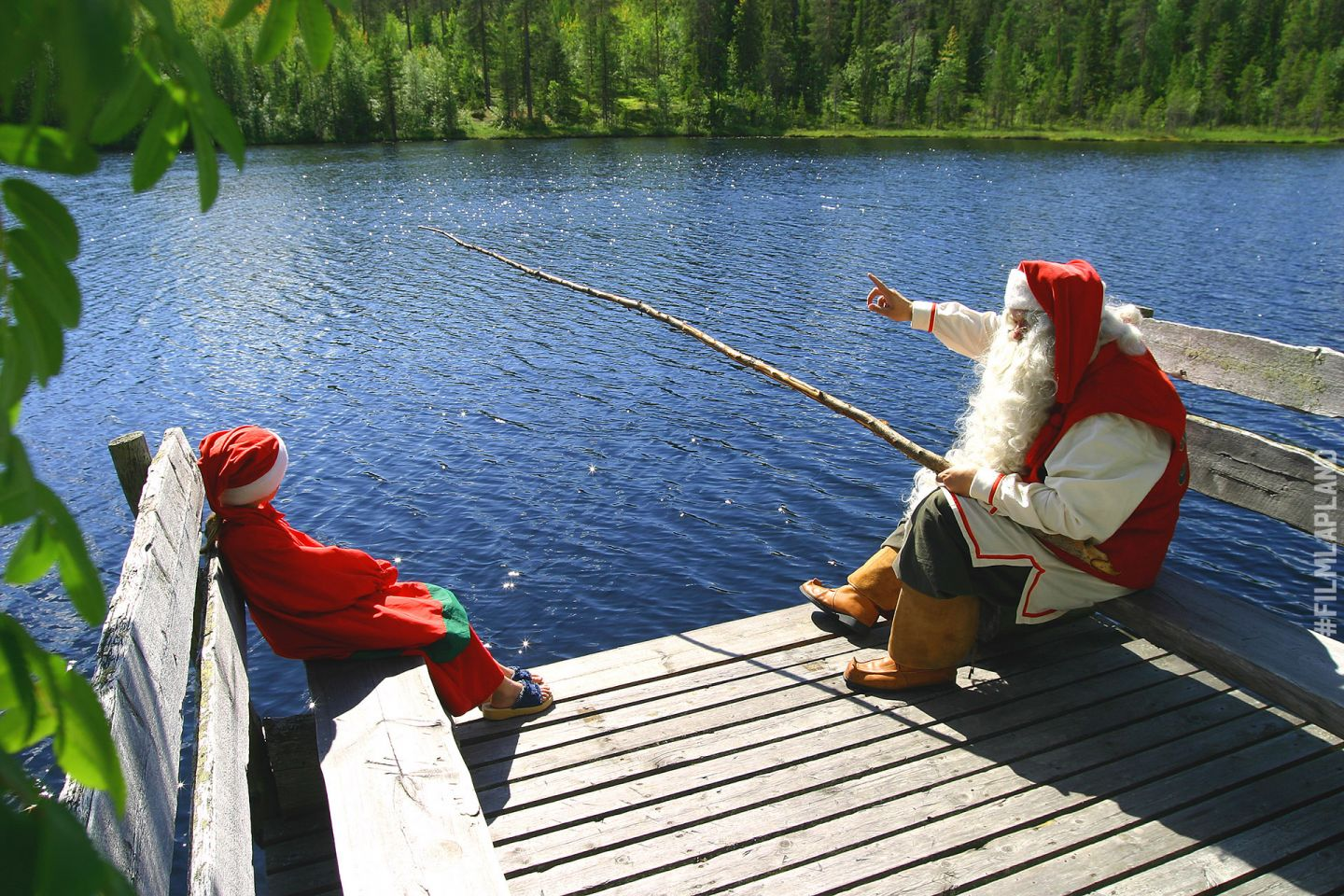 Santa Claus fishing in Rovaniemi, Finland in summer