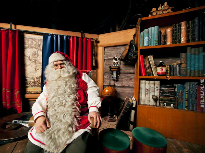 Santa Claus sitting in his office in Arctic Circle, Rovaniemi
