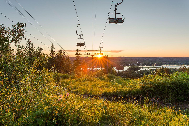 Midnight sun behing the ski lifts in Ounasvaara, Finland