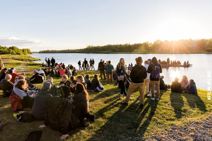 Crowded beach in Midnight Sun Film Festival in Sodankylä, Finland