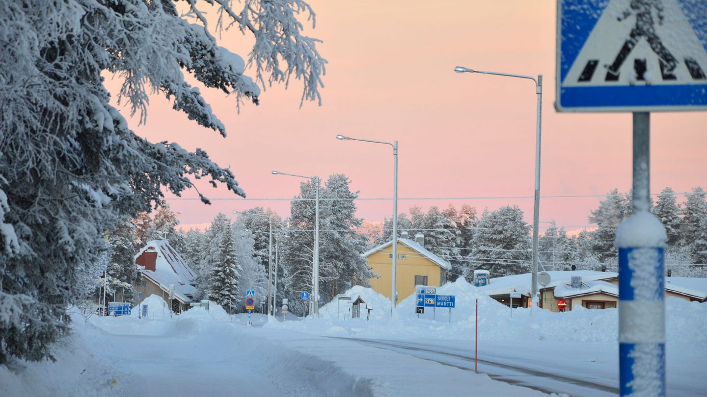 Small town center during the sunset in winter, during the polar night in Savukoski, Finnish Lapland.