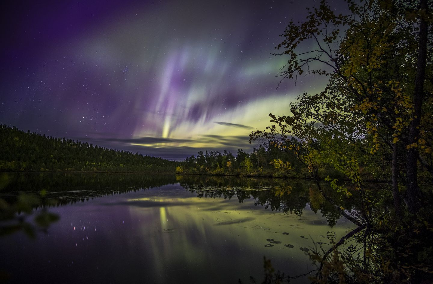 Northern Lights over an Arctic Lake in Lapland, Finland