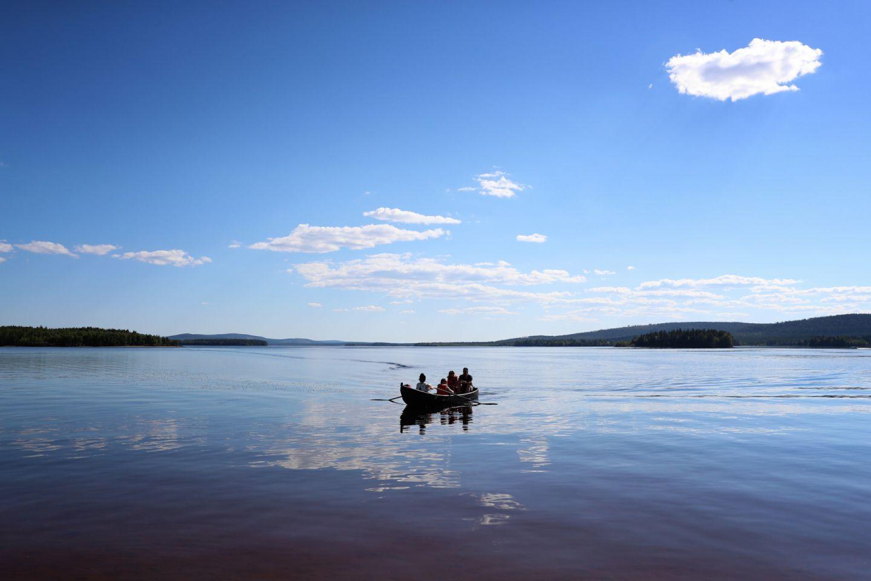 Boating in Lake Kemijärvi, Finland in summer
