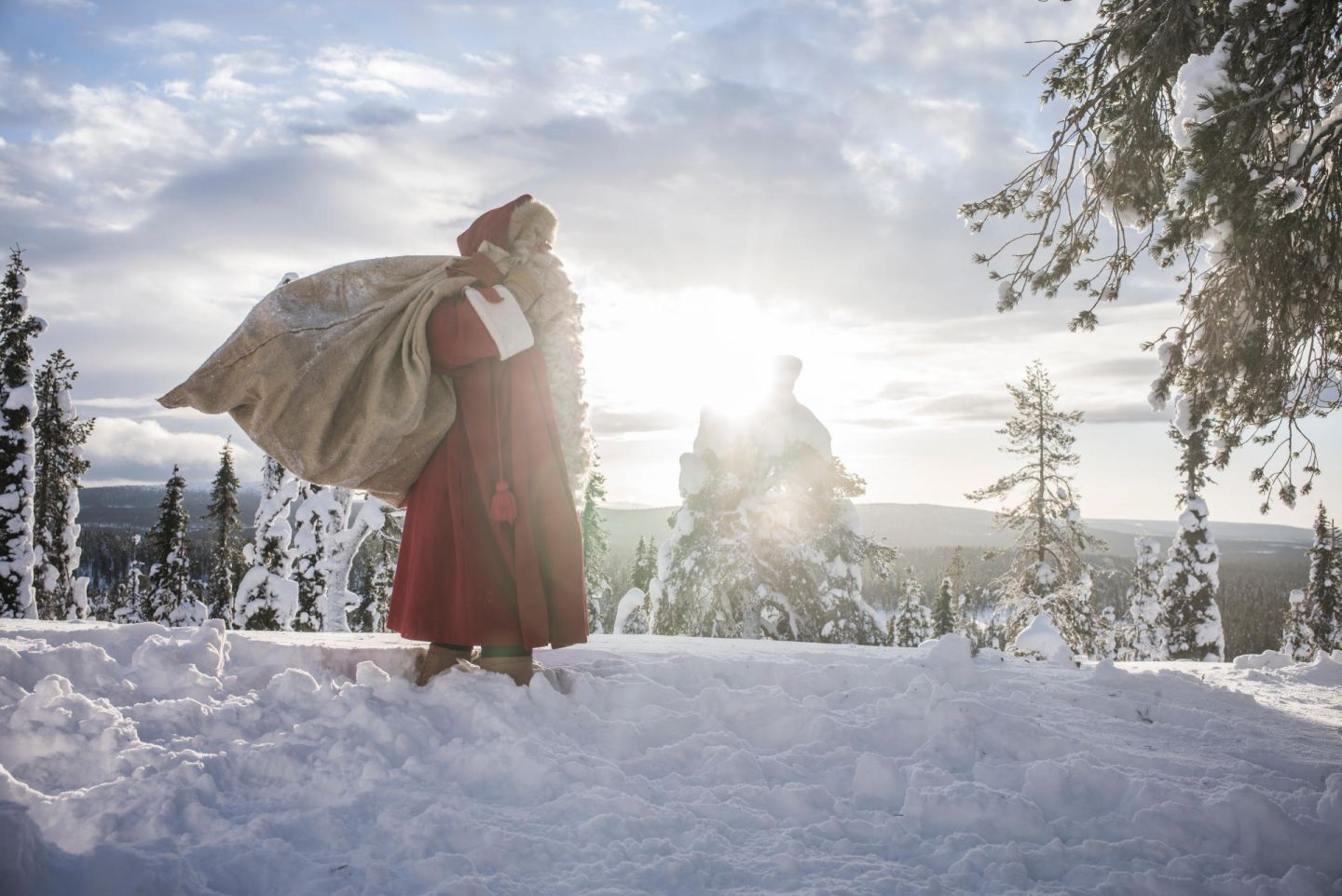 Santa carries a sack of letters and gifts in Finnish Lapland
