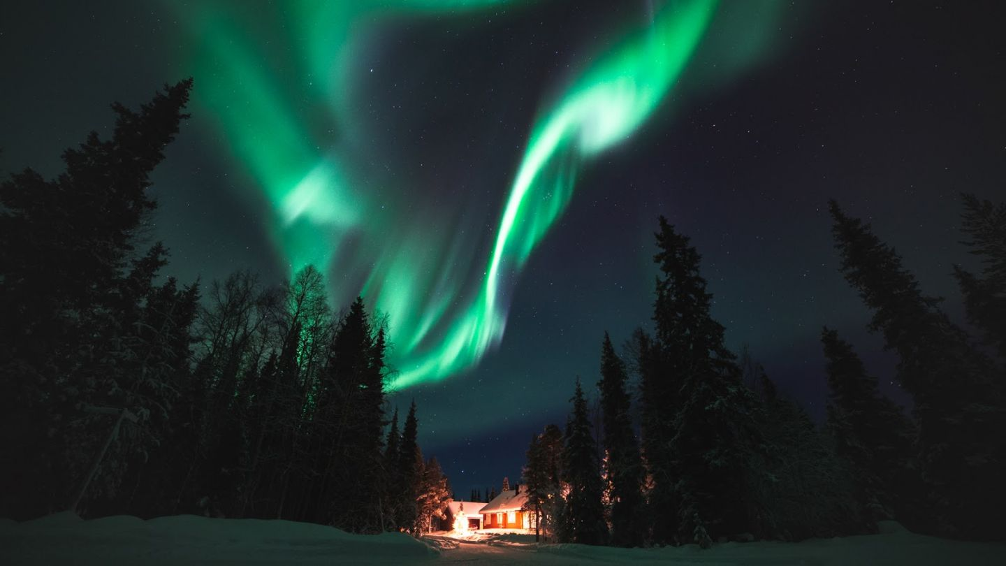 Northern Lights over a cabin in Ylläs, Lapland, Finland