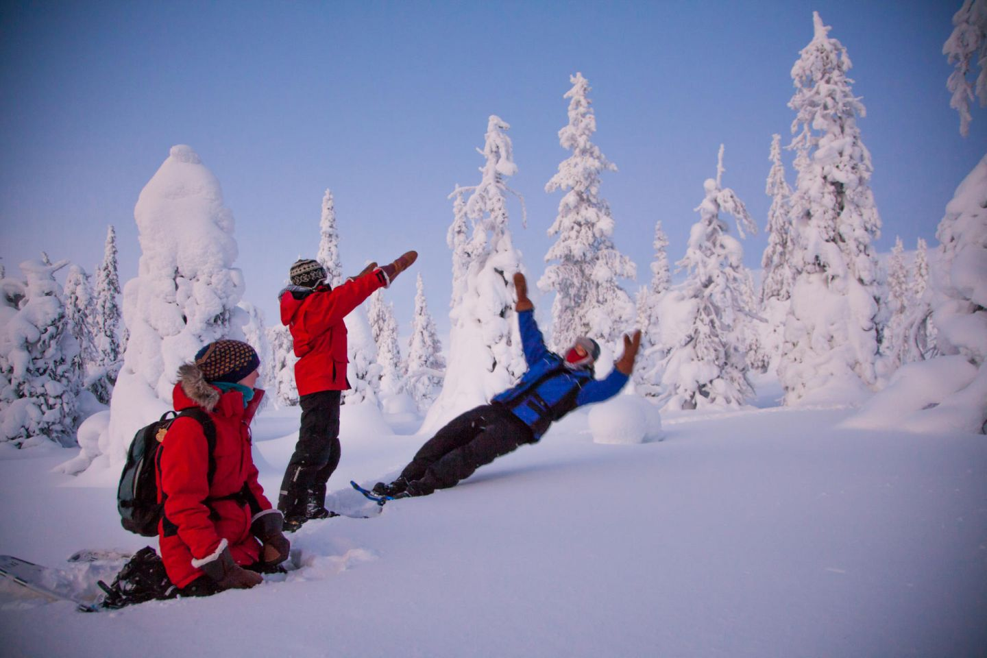 Having fun in the snow in Lapland in winter