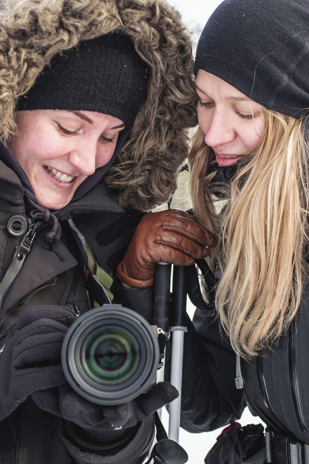 female guides taking photos and smiling