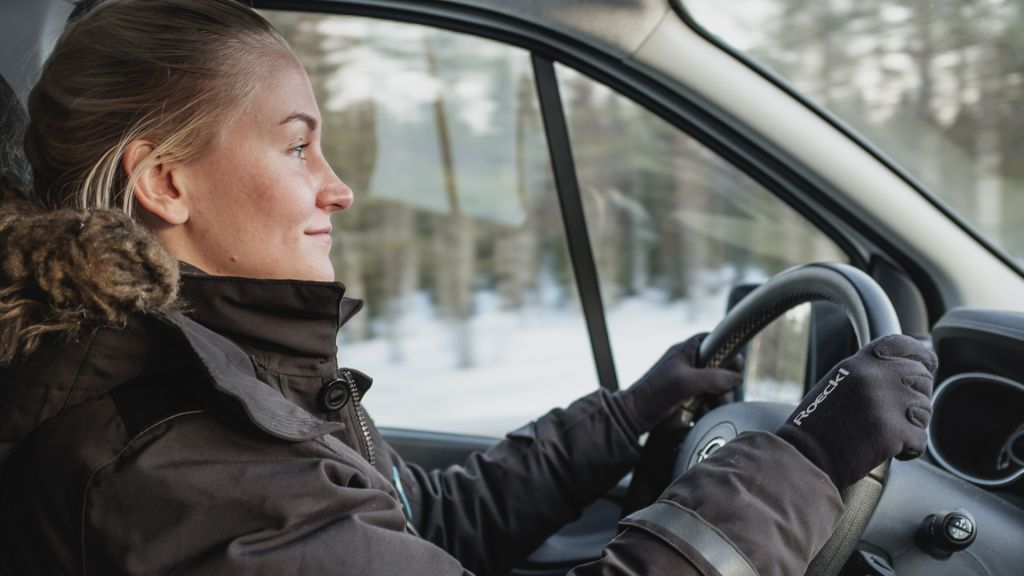 female guide driving car in lapland
