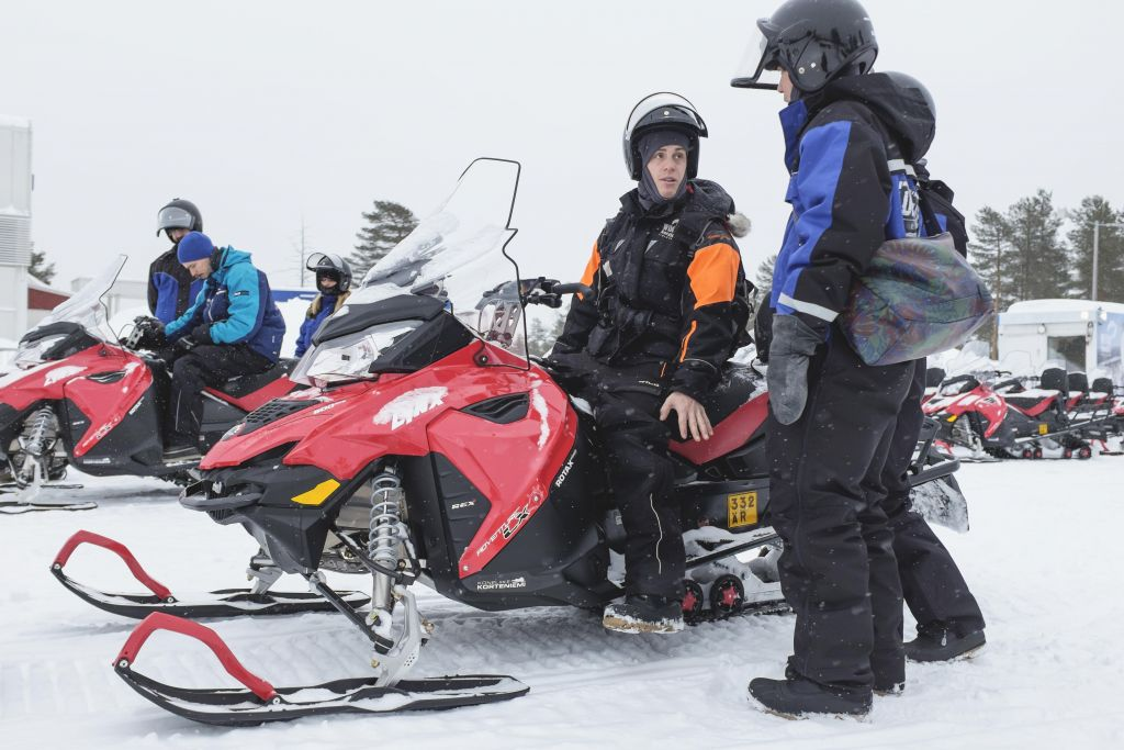 Male snowmobile guide in lapland