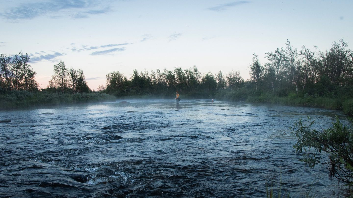 Misty river, fishing Lapland