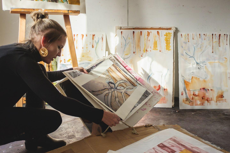 female artists looking through artwork in art studio