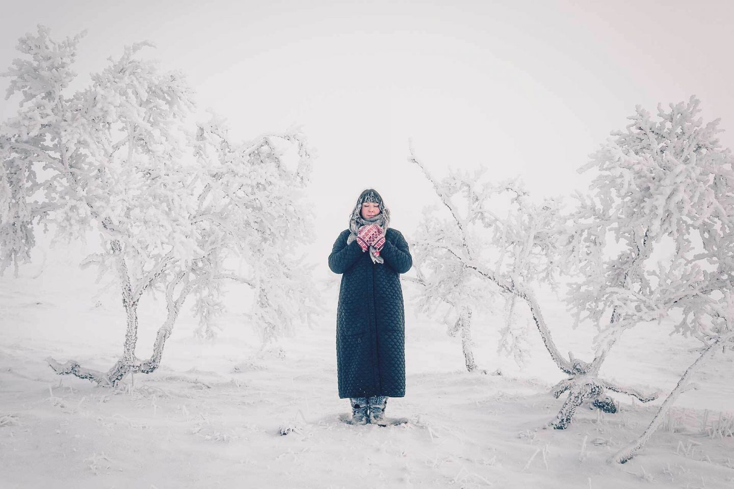 Woman in a snowy forest