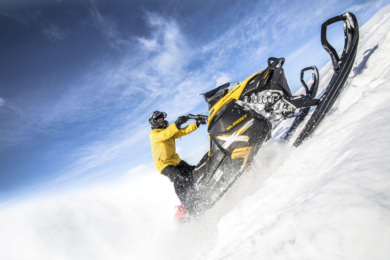 Driving a snowmobile in Inari, Finland
